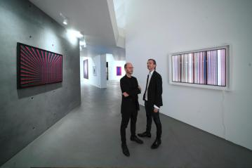 AROTIN & SERGHEI White Shine 2017, Scratched Screen 2011, exhibition view with the artists at Palais Rasmuofsky 2018